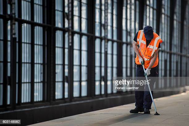 A man cleans the floor of the station Friedrichstrasse on September 12 2016 in Berlin Germany