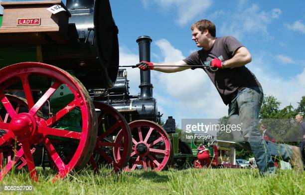 A man cleans the tubes of his steam engine during the Duncombe Park Steam Rally on July 1 2017 in Helmsley United Kingdom Held annually in the...