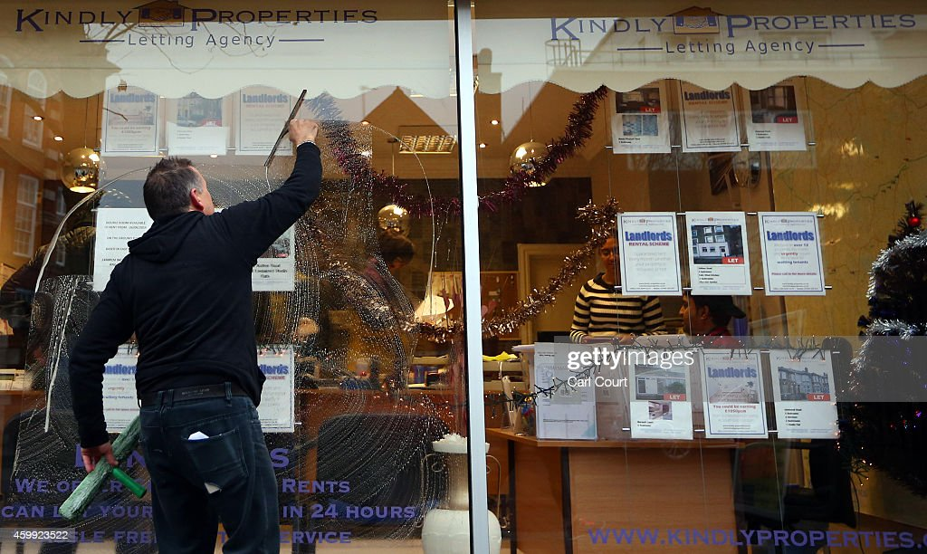 A man cleans the windows of an estate agents on December 4, 2014 in in East Dulwich, London, England. In his autumn statement, Chancellor of the Exchequer, George Osborne, cut the rate of stamp duty for lower-value house sales and raised it on those worth more than £1.5m in a move that would cut the rate of tax for 98% of house purchases.