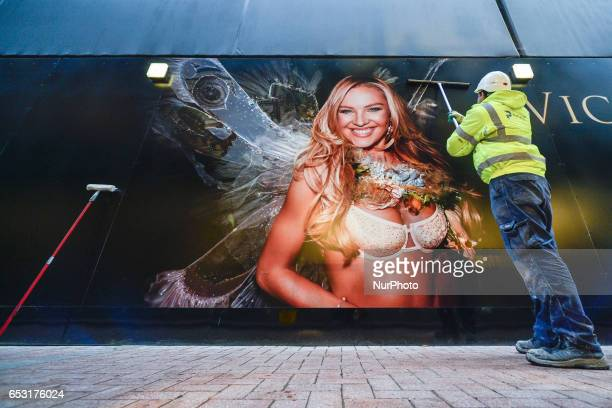 A man cleans Victoria Secret billboard announcing the opening of Dublin based new shop on Grafton Street On Monday March 13 in Dublin Ireland