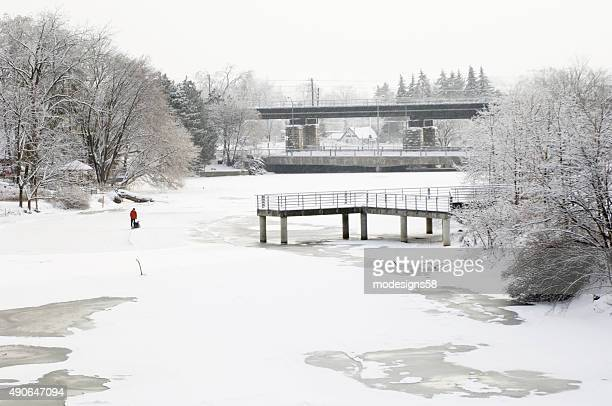 Man Clearing Skating Rink on the Speed River