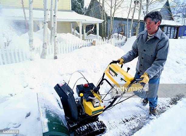 Man Clearing Snow with a Snowblower