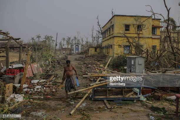 A man clears debris after Cyclone Fani passed through Puri Odisha India on Saturday May 4 2019 A category 4 storm with strong wind and heavy rain...