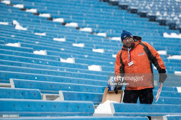 A man clears off seats before a game between the Buffalo Bills and Indianapolis Colts on December 10 2017 at New Era Field in Orchard Park New York