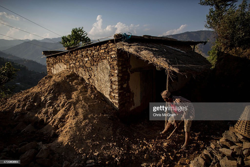 A man clears rubble from his home in Bhotechaur, Nepal on May 3, 2015 in Kathmandu, Nepal. A major 7.9 earthquake hit Kathmandu mid-day on Saturday, and was followed by multiple aftershocks that triggered avalanches on Mt. Everest that buried mountain climbers in their base camps. Many houses, buildings and temples in the capital were destroyed during the earthquake, leaving over 6000 dead and many more trapped under the debris as emergency rescue workers attempt to clear debris and find survivors. Regular aftershocks have hampered recovery missions as locals, officials and aid workers attempt to recover bodies from the rubble.