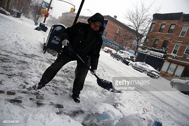 A man clears snow in Brooklyn the morning after a major winter storm on January 27 2015 in New York City Despite dire predictions New York City was...