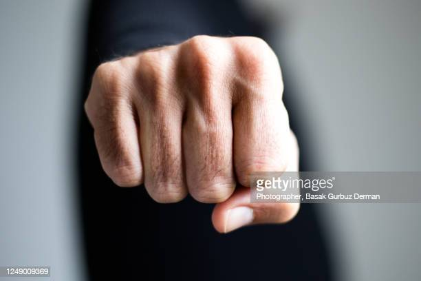 a man clenching fist - black lives matter london stock pictures, royalty-free photos & images