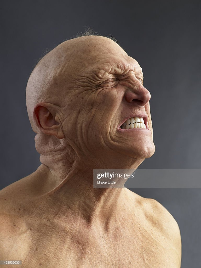 Man Clenching teeth : Stock Photo