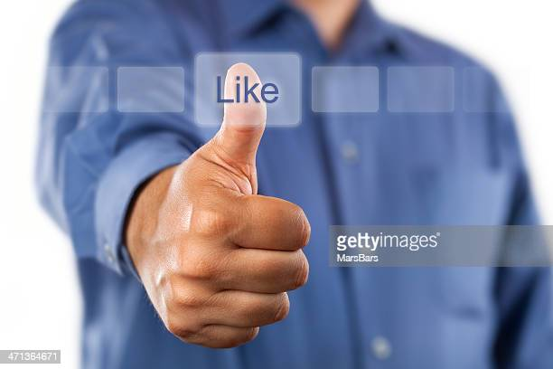 Man clicking like button with thumbs up