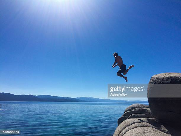Man cliff jumping into Lake Tahoe