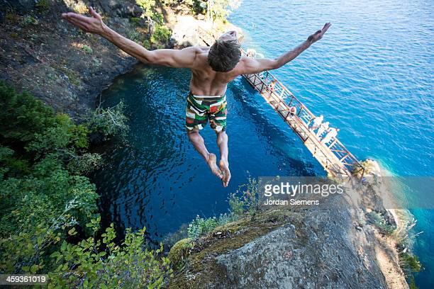 Man cliff jumping