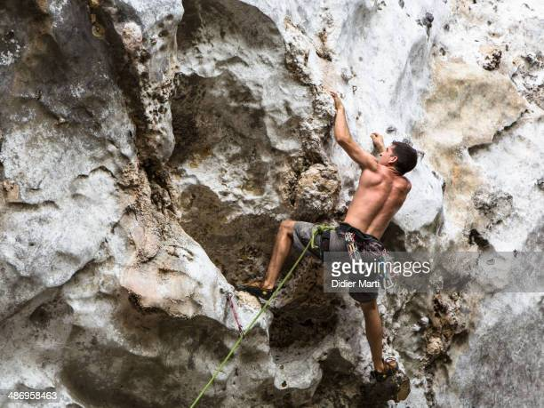 A man climbing a cliff near Kuching in the Sarawak province of Borneo Malaysia