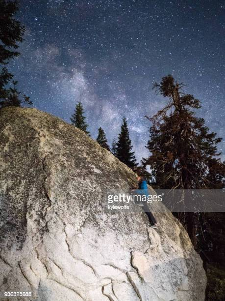 man climbing a granite rock at night, sequoia national forest, california, america, usa - sequoia national forest stock photos and pictures