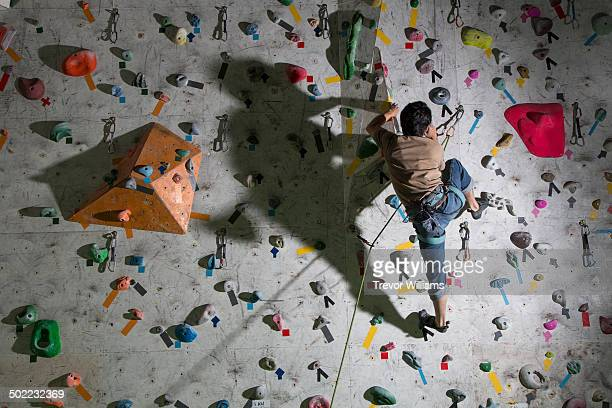 A man climbing at a rock climbing gym