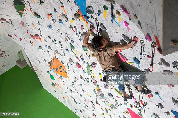 A man climbing at arock climbing gym