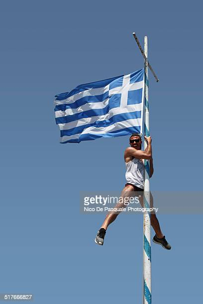 man climbing flag - possible stock pictures, royalty-free photos & images