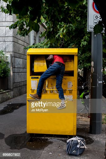 Man climbing into waste container