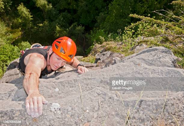 man climbing limestone cliff in south wales - individual event stock pictures, royalty-free photos & images