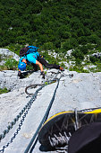 Man climbing on a rocky wall