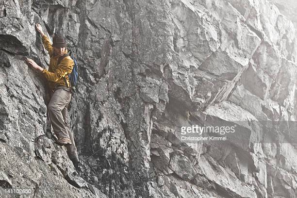 man climbing on granite rock - grouse mountain stock photos and pictures