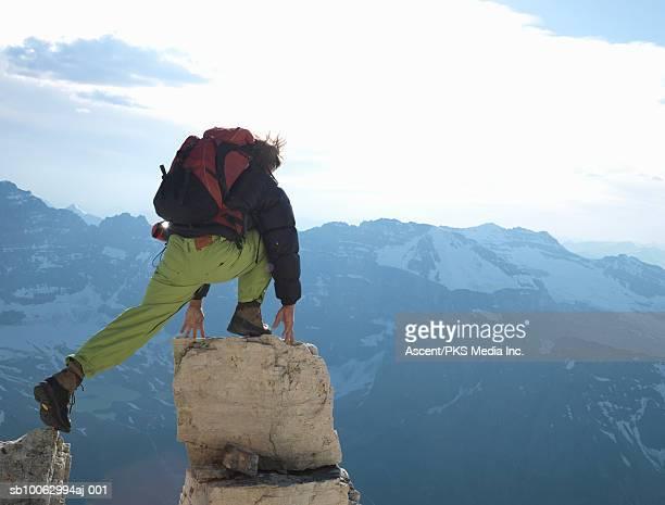 Man climbing on rock pinnacle