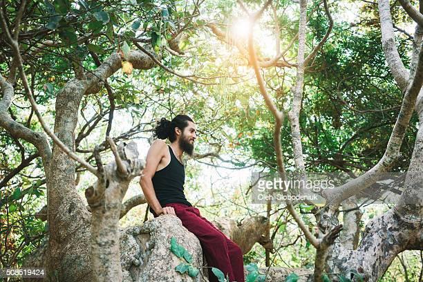 Man climbing on the tree