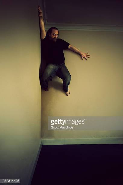 man climbing on wall - scott macbride stock pictures, royalty-free photos & images