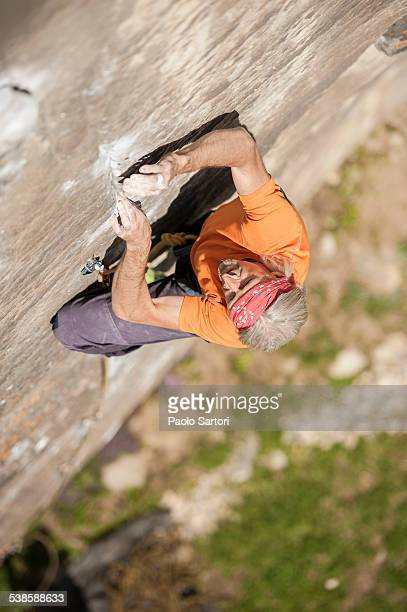 man climbing re azul, an historic 7b route on granite crag of balmanolesca, varzo, italy. - granite stock pictures, royalty-free photos & images