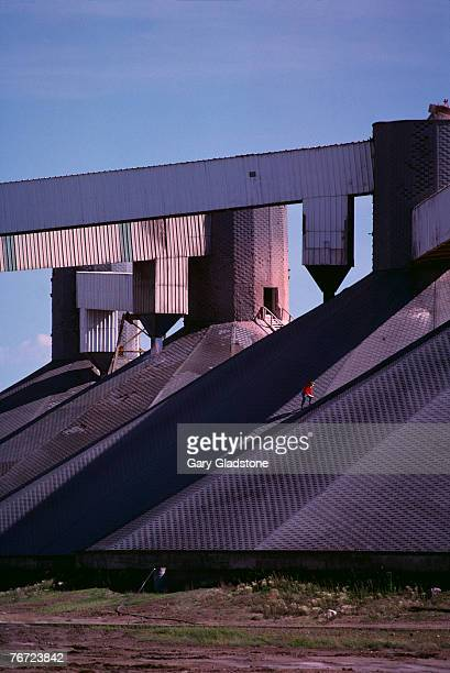 man climbing rooftop stairway - potash stock pictures, royalty-free photos & images