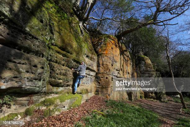 Man climbing sandstone rockface