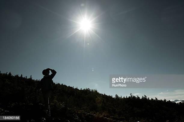 man climbing the mountain,break time