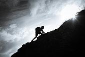 Man climbing up a mountain.