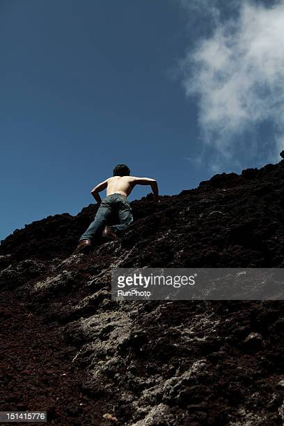 Man Climbing up Rocks
