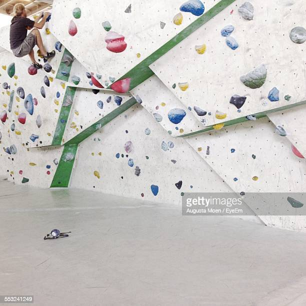 Man Climbing Wall At Training Class