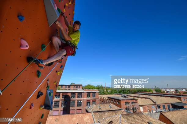 Man climbs on the new climbing wall with a height of 25 meters, in Mulhouse, eastern France, on September 4, 2020. - The Climbing Mulhouse Center,...
