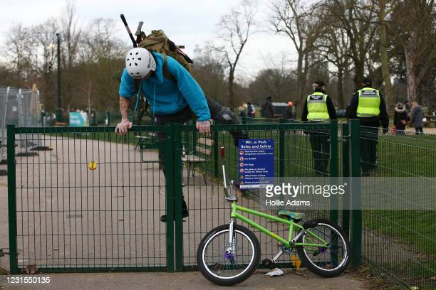 Man climbs over a face after being asked by Tower Hamlets Enforcement Officers to leave the closed Victoria Park skatepark on March 6, 2021 in...