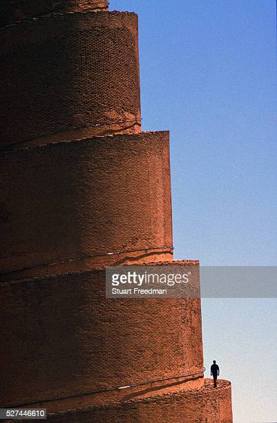 A man climbs the minaret of the ancient mosque of AlMutawakkil The first mosque built in 836 CE has now disappeared it was replaced in 849852 CE by a...