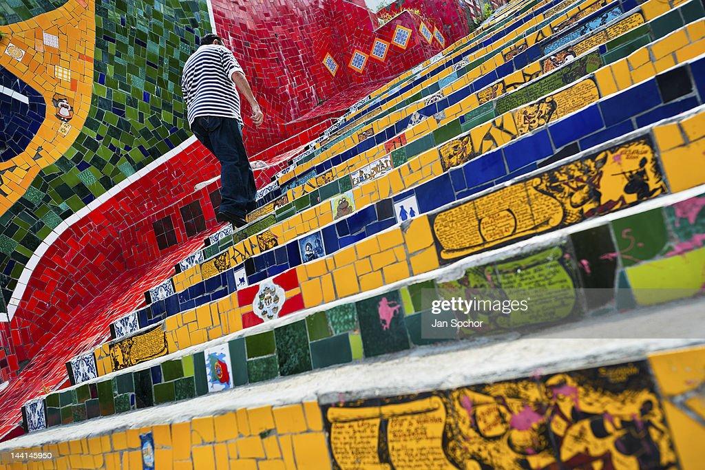 A Man Climbs The Selaronu0027s Stairs (Escadaria Selarón), A Mosaic Staircase  Made Of