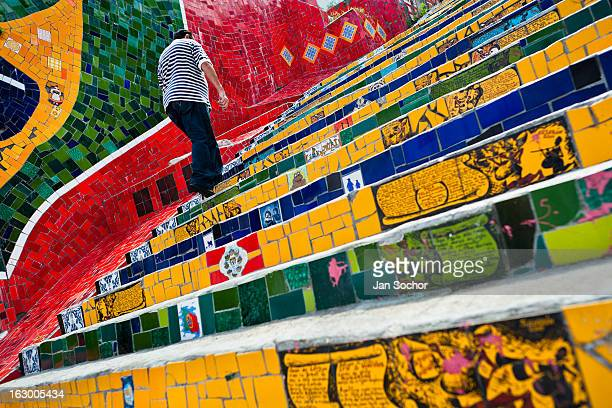 CONTENT] A man climbs the Selaron's Stairs a mosaic staircase made of colorful tiles in Rio de Janeiro Brazil 12 February 2012 Worldfamous staircase...