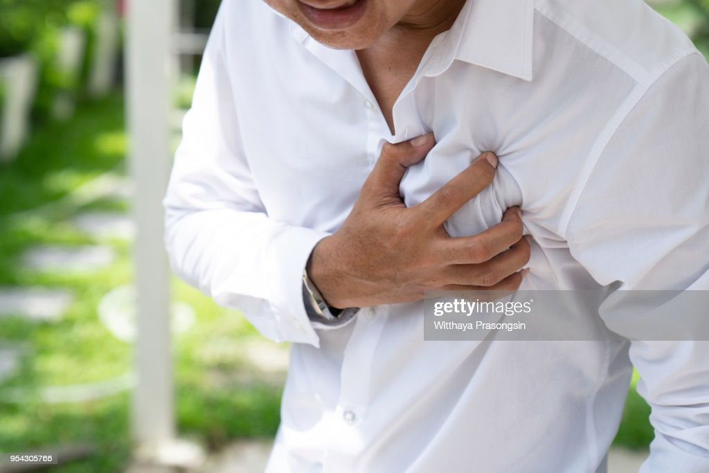 Man clutching his chest from acute pain.Heart attack symptom-Healthcare and medical concept. : Stock Photo