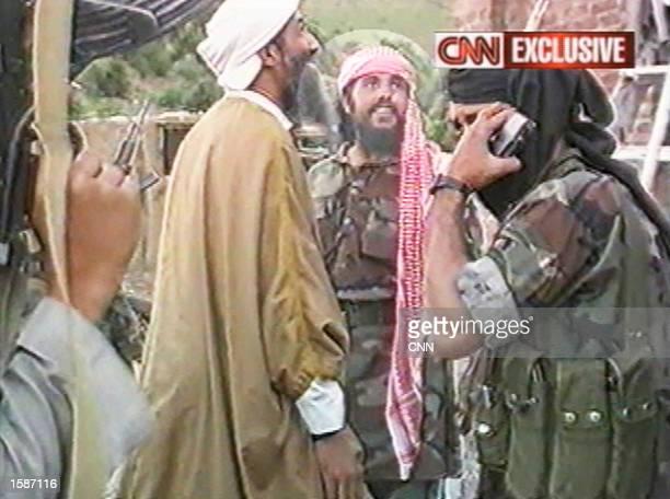 Man CNN identifies as Qaed Senyan al-Harthi stands next to al Qaeda leader Osama Bin Laden on May 26, 1998 in Afghanistan. According to CNN,...