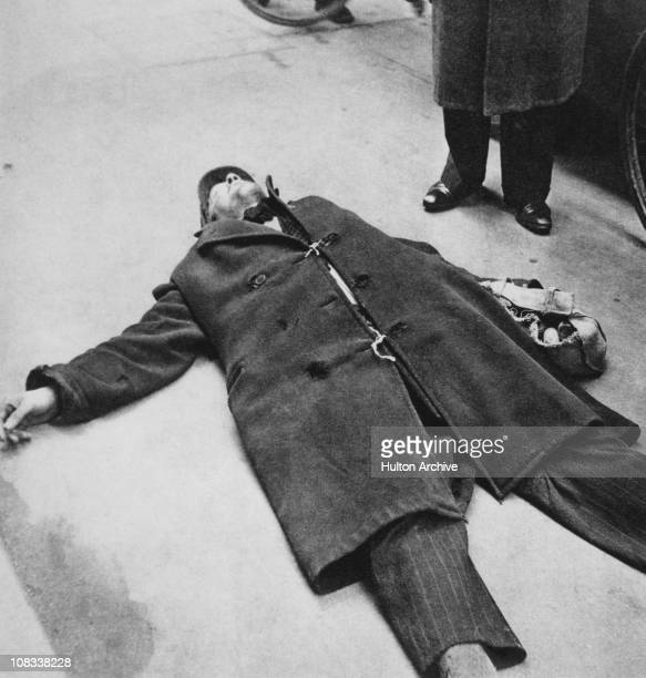A man collapsed on the street from starvation during the Dutch famine of the winter of 194445 Netherlands circa 1945