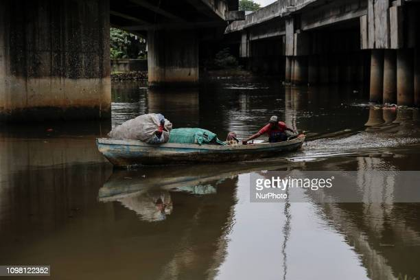 A man collecting plastic waste for recycling from the polluted Ciliwung river in Jakarta Indonesia on February 12 2019 Plastic pollution in Indonesia...