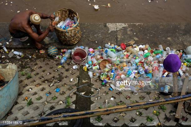 A man collecting plastic waste for recycling from the River in Jakarta Indonesia on February 17 2019 Plastic pollution in Indonesia is second only to...