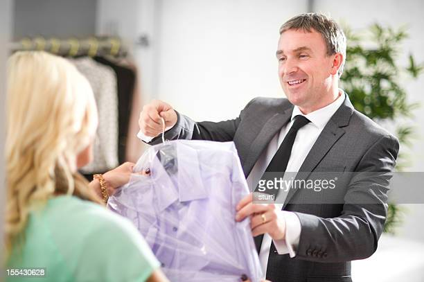 man collects dry cleaning