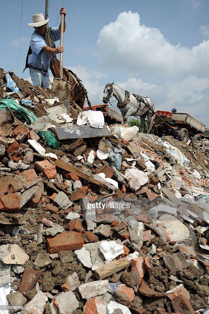A man collects trash from a wrecked building on May 25, 2010 in Cali, Colombia.