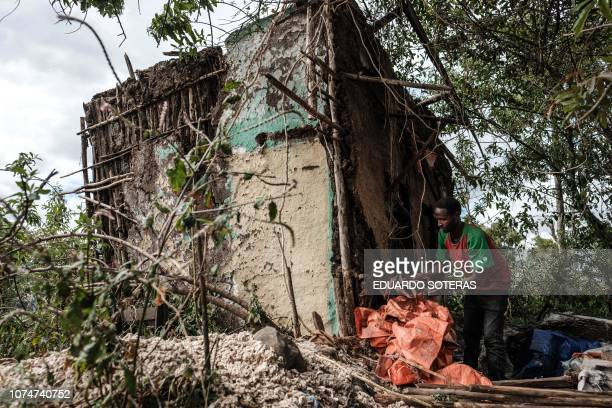 A man collects usable items from a house that is about to be demolished in Addis Ababa on November 29 2018 Palatial homes are scattered throughout...