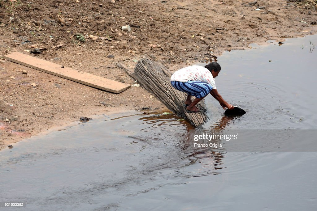 A man collects water from the river Nyong in the village of Mbalmayo (south Yaounde) on February 19, 2018 in Yaounde, Cameroon. Cameroon is often referred to as 'Africa in miniature' for its geological and cultural diversity. Natural features include beaches, deserts, mountains, rainforests, and savannas.