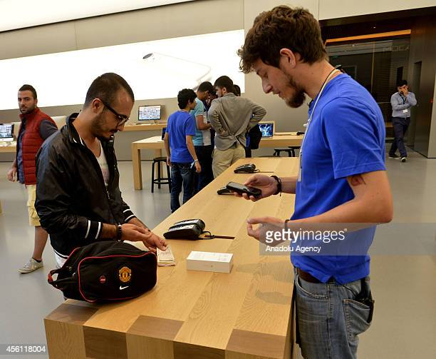 A man comes from Izmir west of Turkey pays to buy iPhone 6 as iPhone 6 and iPhone 6 Plus retail sales begin at Apple Store Zorlu Center in Istanbul...