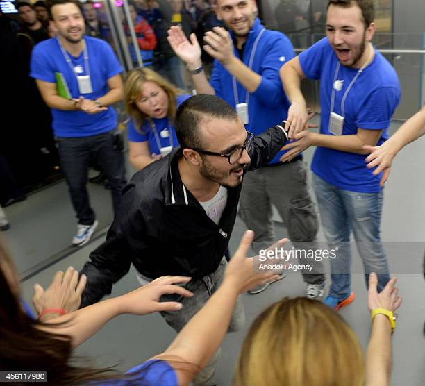 A man comes from Izmir west of Turkey to buy iPhone 6 cheers up as iPhone 6 and iPhone 6 Plus retail sales begin at Apple Store Zorlu Center in...
